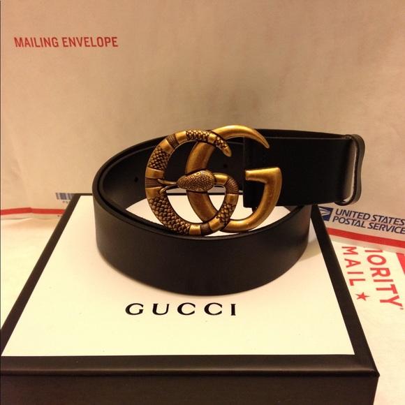 62057824125 Gucci black leather snake buckle belt